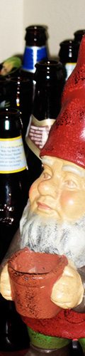 The gnome that I got Mindy for Valentine's day is guarding the many empty beer bottles that accumulated while she was in Rome.